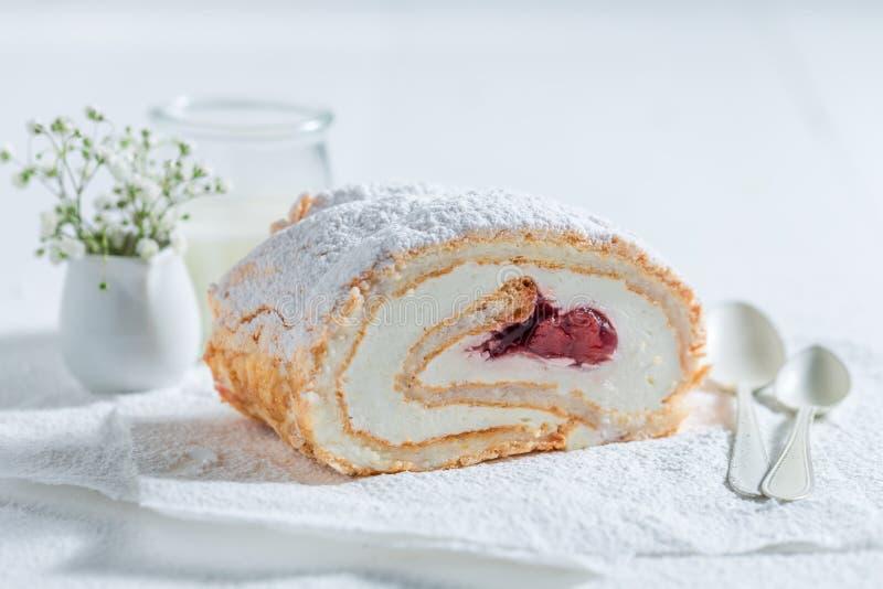 Delicious meringue cake made of fresh strawberry. On white background stock images