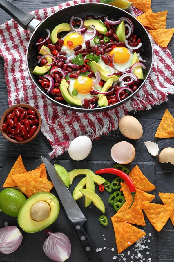 Mexican breakfast with fried egg, red bean royalty free stock image