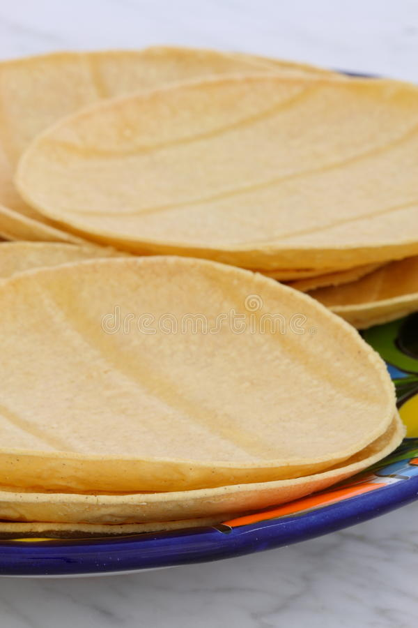Delicious mexican corn tortillas. Mexican corn tortillas on retro vintage carrara marble in beautiful talavera plate, perfect for all your Mexican and tex-mex stock image