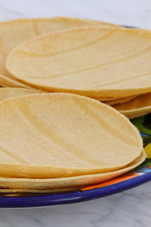 Delicious mexican corn tortillas. Mexican corn tortillas on retro vintage carrara marble in beautiful talavera plate, perfect for all your Mexican and tex-mex royalty free stock photos