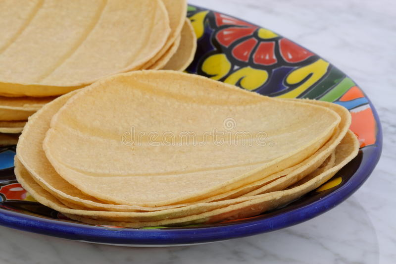 Delicious mexican corn tortillas. Mexican corn tortillas on retro vintage carrara marble in beautiful talavera plate, perfect for all your Mexican and tex-mex royalty free stock photo