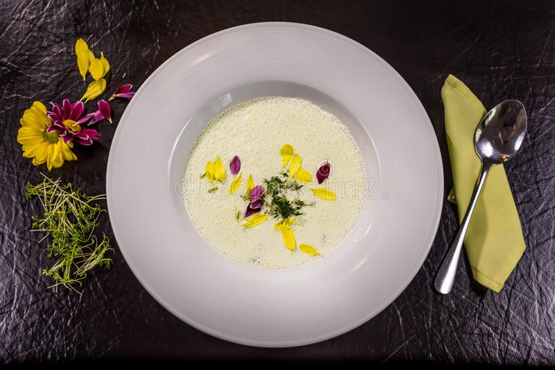 Delicious milk soup in a plate placed on a table royalty free stock images