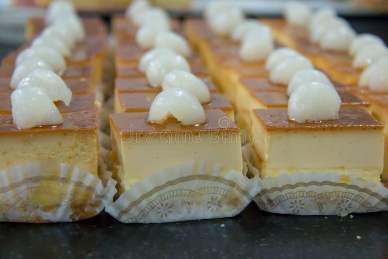 Delicious mini caramel cheese cake with fruit royalty free stock photos