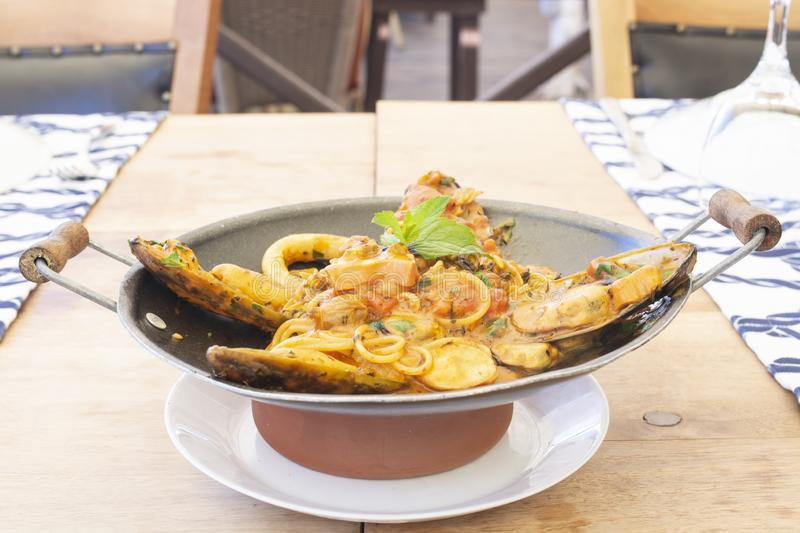 Delicious mix seafood pasta on wood royalty free stock photography
