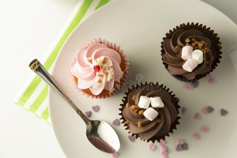 Delicious Mothers day chocolate cupcakes. Sweet dessert. Birthday, party food. Bright background. Food photo. Delicious chocolate cupcakes. Sweet dessert stock photo