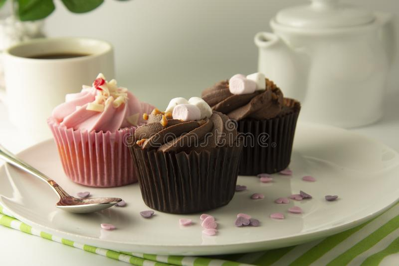 Delicious Mothers day chocolate cupcakes. Sweet dessert. Birthday, party food. Bright background. Food photo. Delicious chocolate cupcakes. Sweet dessert royalty free stock image