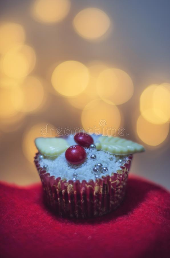 A delicious muffin with blurred lights in the background stock photo