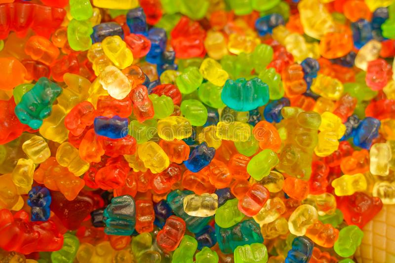 Delicious multi-colored fruit marmalade. unhealthy bright candies in bulk. different jelly photo close. tasty sweets in the candy. Shop. nobody.  many royalty free stock photography