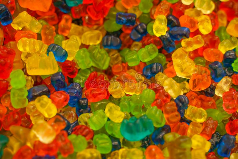 Delicious multi-colored fruit marmalade. unhealthy bright candies in bulk. different jelly photo close. tasty sweets in the candy. Shop. nobody.  many stock photo