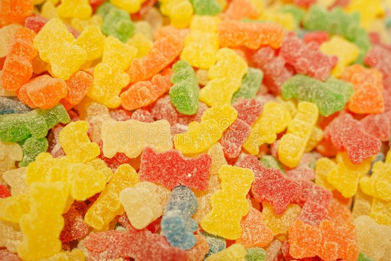 Delicious multi-colored fruit marmalade. unhealthy bright candies in bulk. different jelly photo close. tasty sweets in the candy. Shop. nobody.  many royalty free stock image