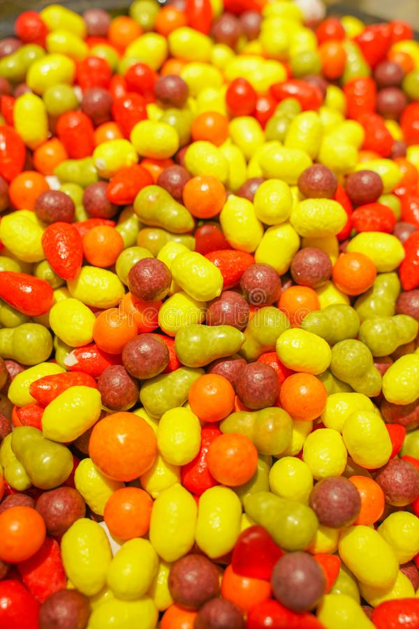 Delicious multi-colored fruit marmalade. unhealthy bright candies in bulk. different jelly photo close. tasty sweets in the candy. Shop. nobody.  many stock photos