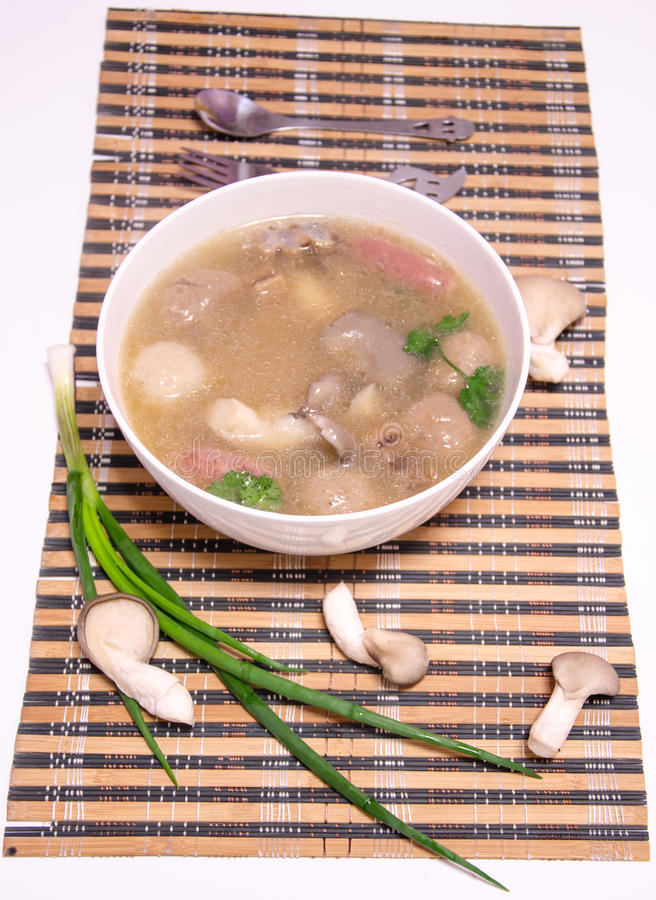 Delicious mushroom meatballs soup cooking noodles stock image