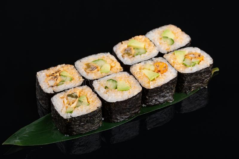 Delicious mussel sushi roll set on banana leaf royalty free stock photo