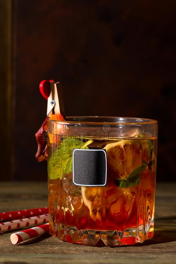 Delicious negroni cocktails with campari, gin, vermouth, and a citrus orange twist isolated on black. Holiday aperitif royalty free stock image