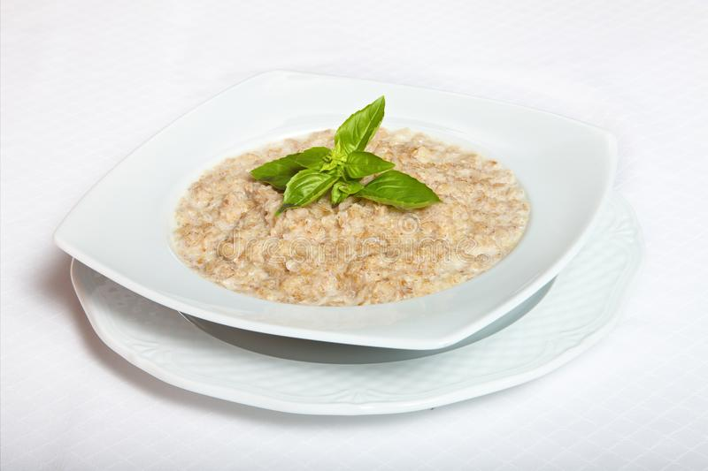 Delicious nutritious and healthy fresh old fashioned oatmeal royalty free stock images