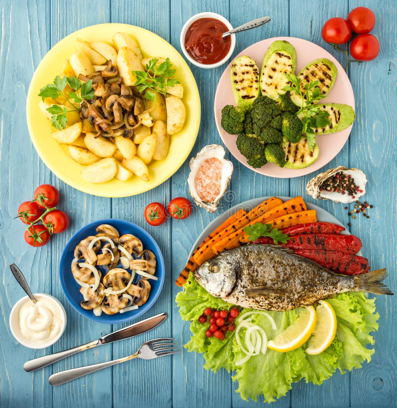 Delicious and nutritious meal with fish and vegetables. Top view royalty free stock image