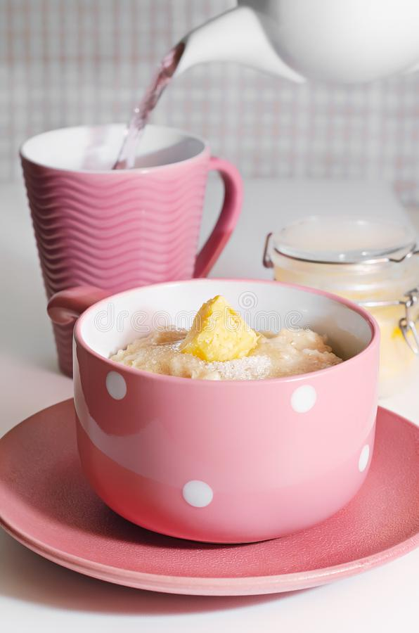 Delicious oatmeal for Breakfast, with sugar and melted butter royalty free stock photo