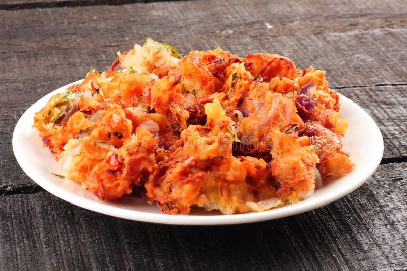 Delicious onion pkkoda. Indian spicy onion pkkoda or pakoras stock photo