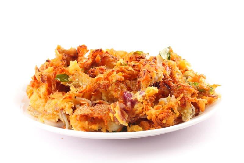 Delicious onion pkkoda. Indian spicy onion pkkoda or pakoras royalty free stock photography