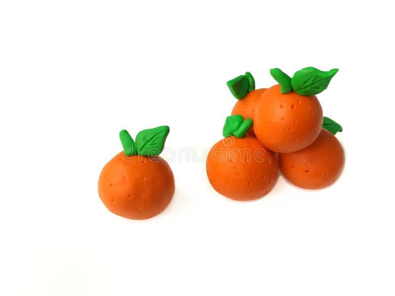 Delicious oranges plasticine clay, colorful fruit dough, different idea stock image