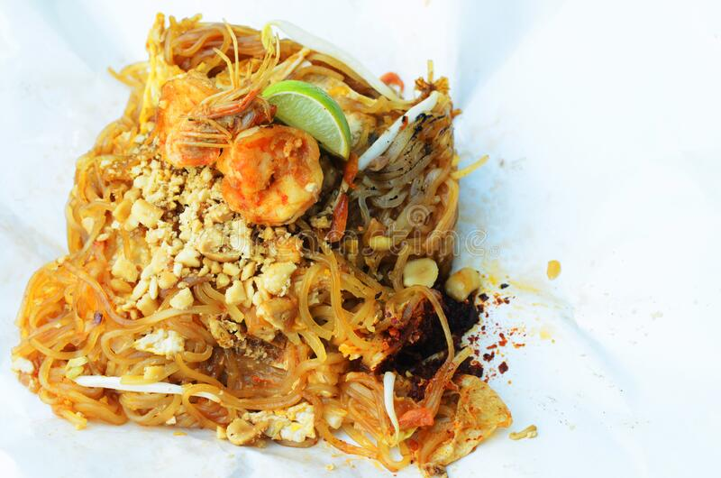 Delicious Pad thai and shrimp with paper package for Thai noodle food. Concept royalty free stock photos