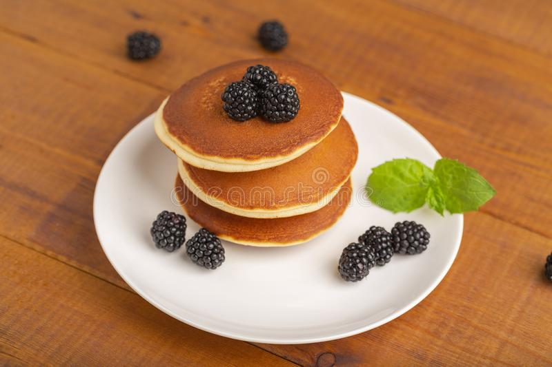 Delicious pancakes with BlackBerry and mint, on a white plate stock photography