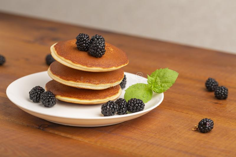 Delicious pancakes with BlackBerry and mint, on a white plate stock image