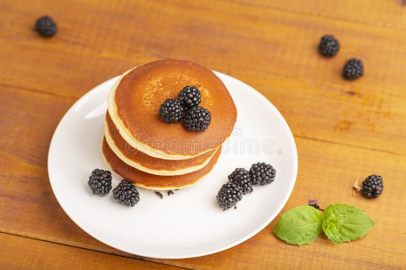 Delicious pancakes with BlackBerry and mint, on a white plate stock images