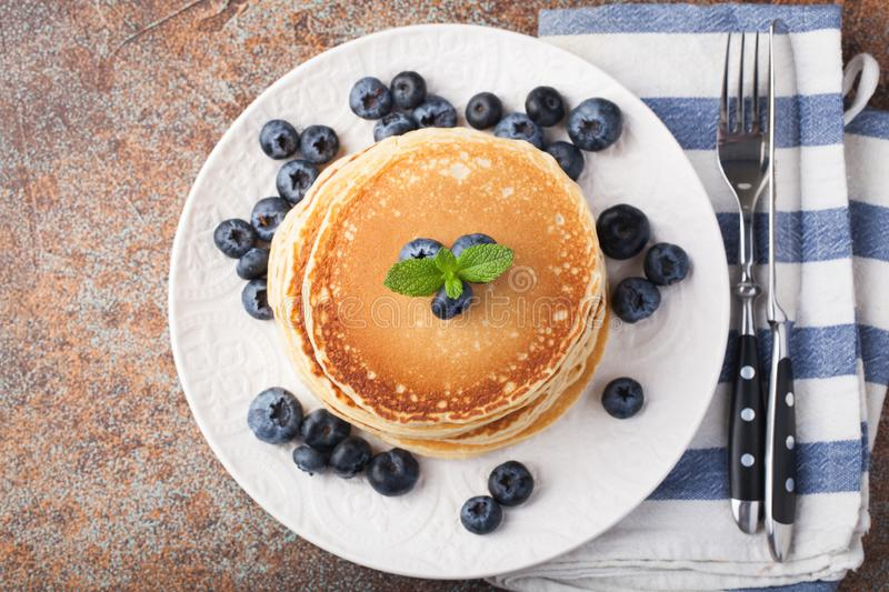 Delicious pancakes close up, with fresh blueberries on rusty background. Top view with copy space royalty free stock images