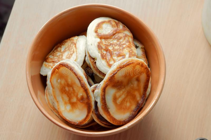 Delicious pancakes in a deep bowl, pancakes in a brown plate royalty free stock photos