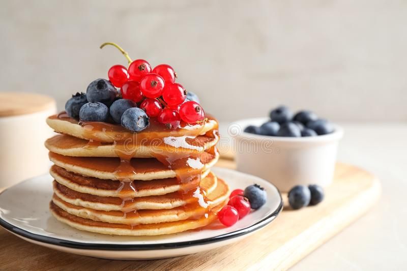Delicious pancakes with fresh berries and syrup stock photos