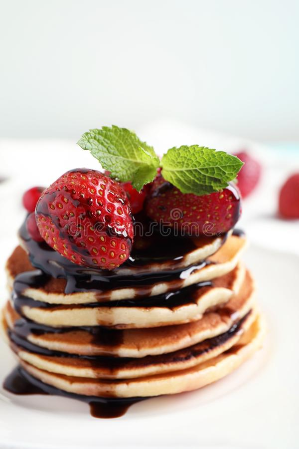 Delicious pancakes with fresh strawberries and chocolate syrup royalty free stock photos