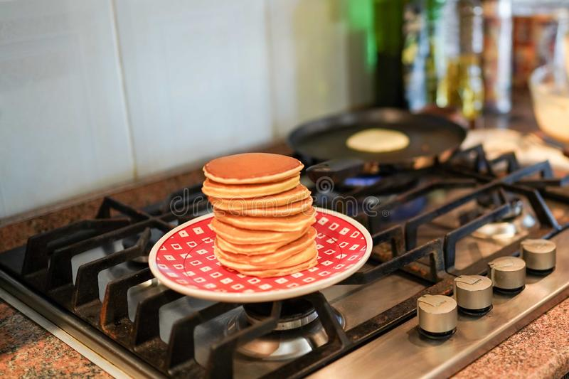 Delicious pancakes on oven background. tasty healthy food breakfast for all family. Fritters royalty free stock photos