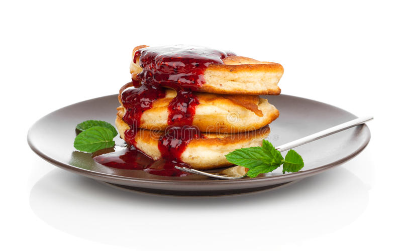 Delicious pancakes with raspberries sauce stock photography