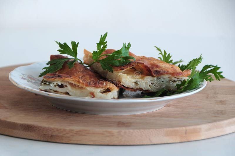 Delicious and parsley in plate cheese pie stock photo