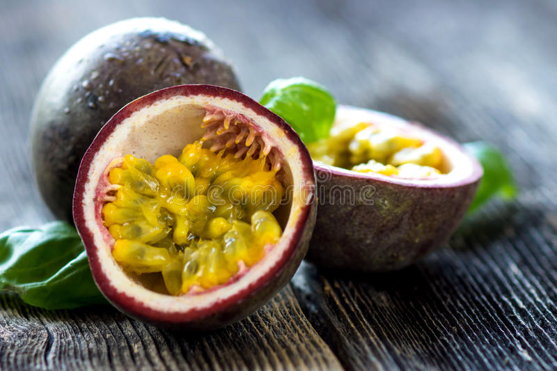 Delicious passion fruit on wooden background stock images