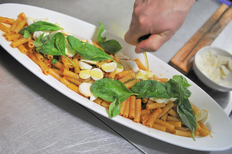 Delicious pasta and basil royalty free stock photography