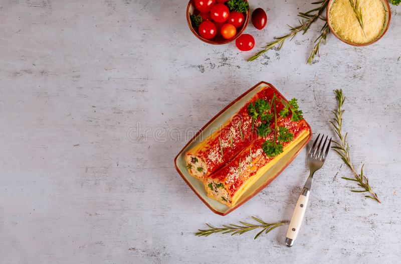 Delicious pasta cannelloni stuffed with ricotta and spinach stock images