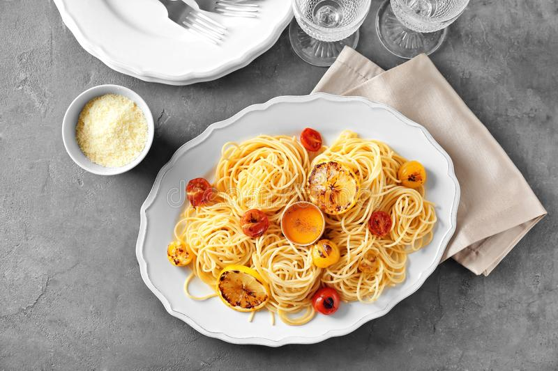 Delicious pasta with egg yolk and vegetables stock image