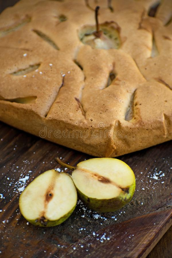 Delicious pear tart on table. Pear tatin pie on wooden board. Homemade organic fresh pear fruit pie or tart backed stock photo