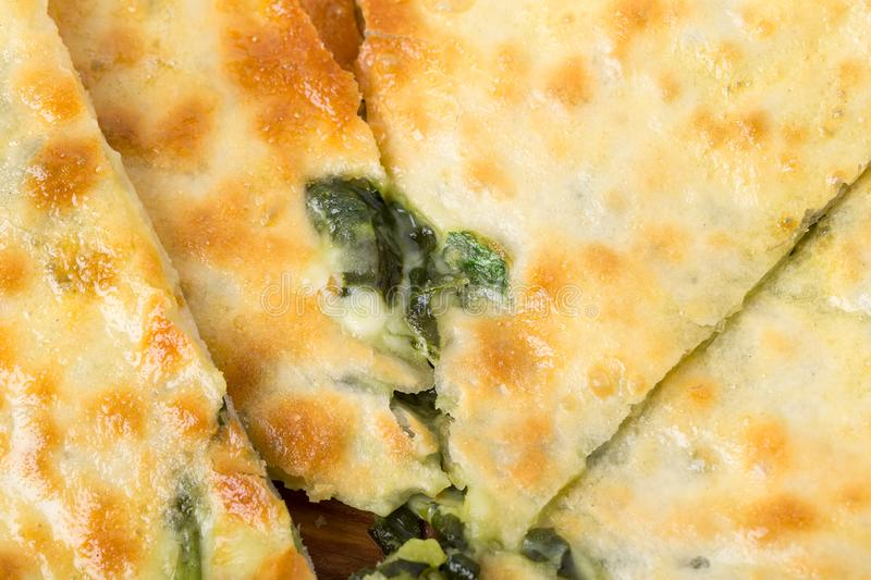Delicious pie stuffed with spinach royalty free stock image