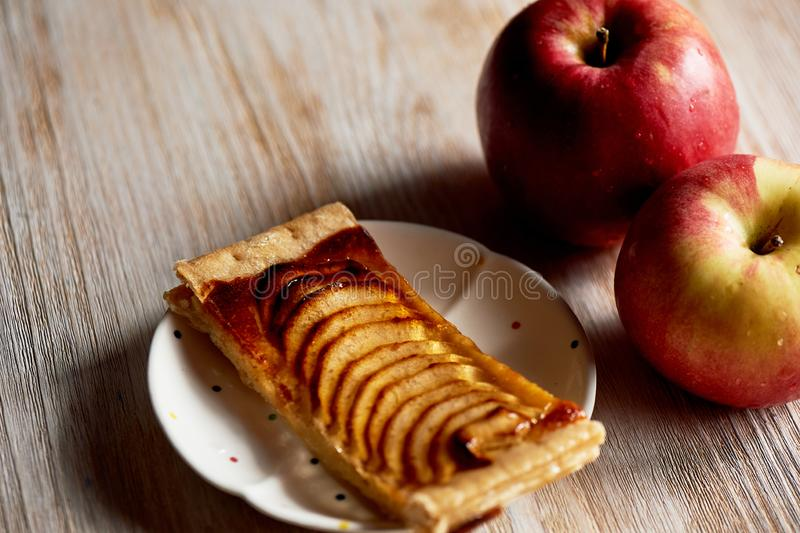 A delicious piece of Apple pie, red apples.Tea party. A delicious piece of Apple pie, red apples. Tea party royalty free stock photos