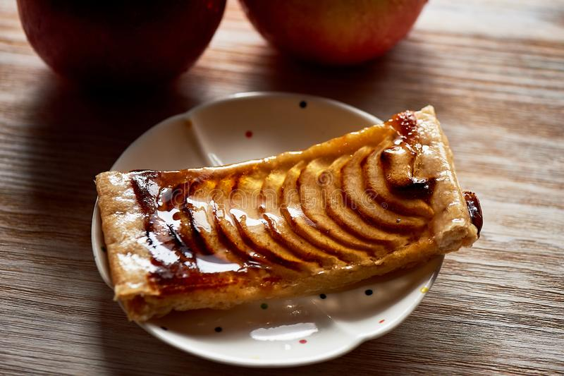 A delicious piece of Apple pie, red apples.Tea party. A delicious piece of Apple pie, red apples. Tea party stock photography