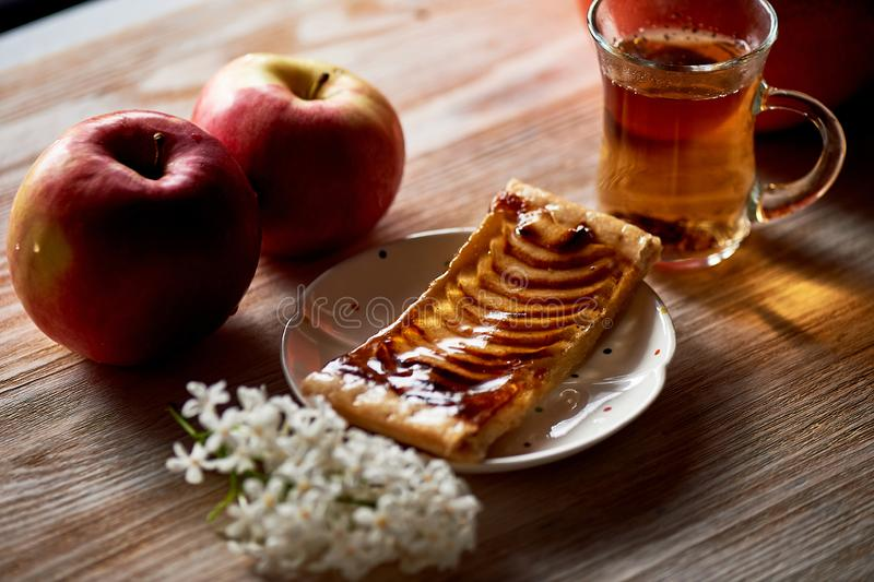 A delicious piece of Apple pie, red apples.Tea party. A delicious piece of Apple pie, red apples. Tea party stock image