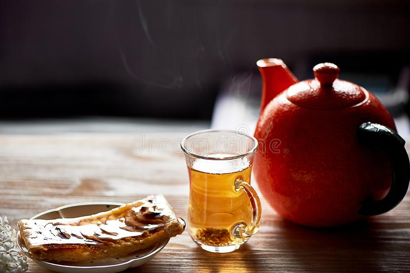 A delicious piece of Apple pie, red apples.Tea party. A delicious piece of Apple pie, red apples. Tea party royalty free stock image