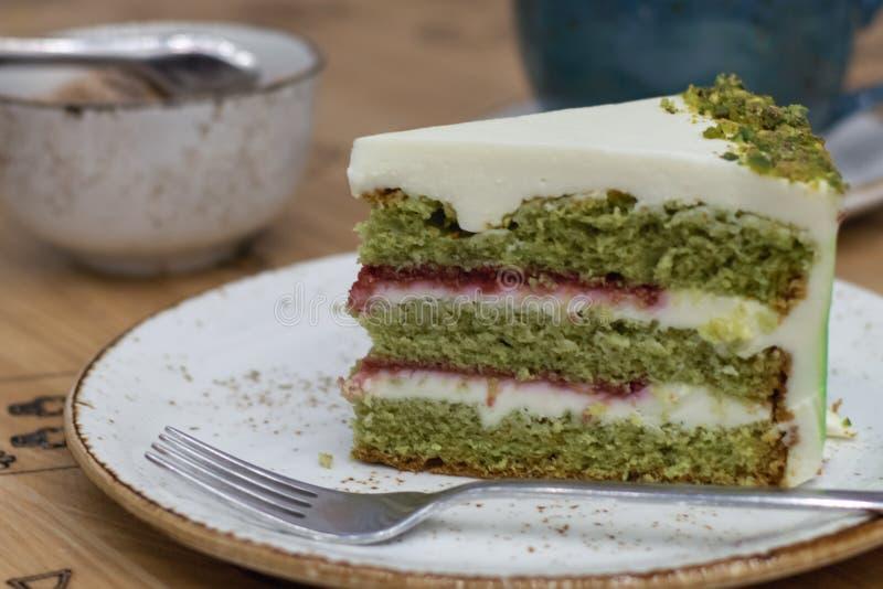 Delicious pistachio cake closeup royalty free stock photo