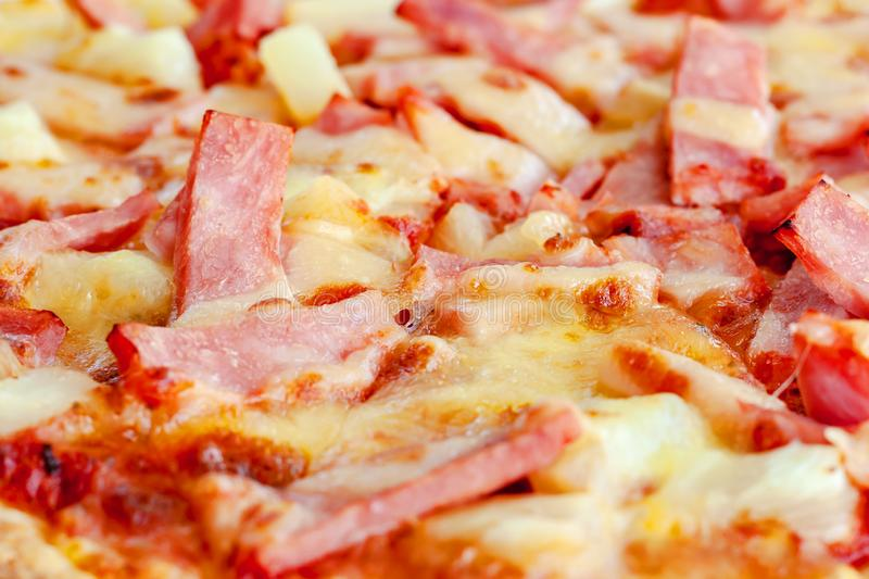 Delicious pizza with pineapple, ham slice, bacon slice, mozzarella cheese, pizza sauce. For fast food and ready to eat concept stock photo