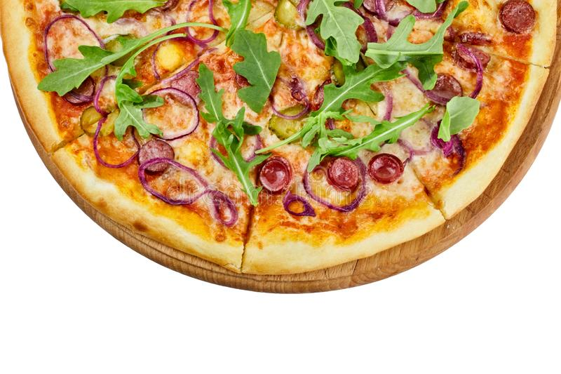 Delicious pizza with sausages mozzarella sauce cucumber and onions on a wooden board on an isolated white background stock photography