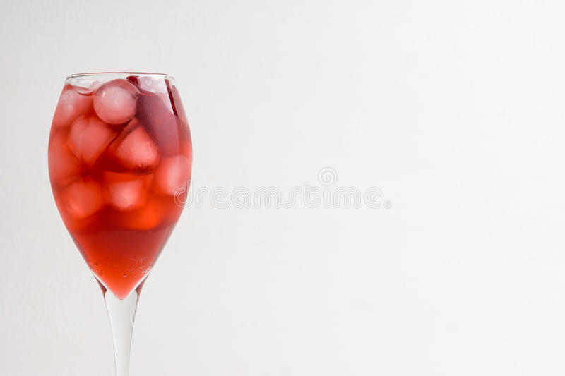 Delicious pomegranate cocktail. On the white wooden background royalty free stock image