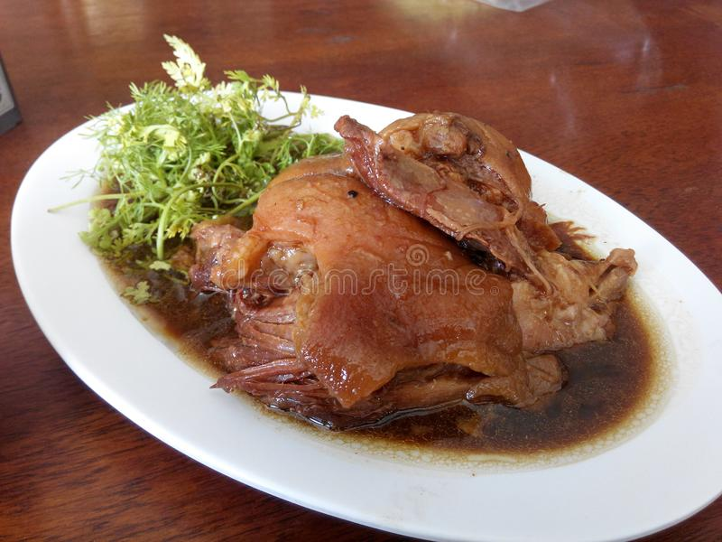 Delicious Pork leg steamed. Pork leg Steamed in Herbal soup ,Chinese style. This picture was taken in THailand royalty free stock image